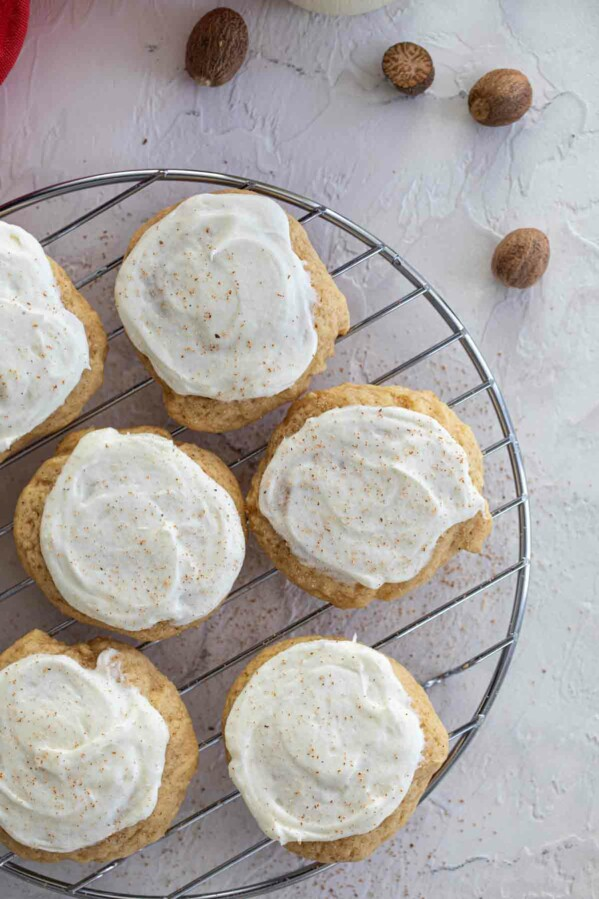 eggnog cookies with frosting and nutmeg