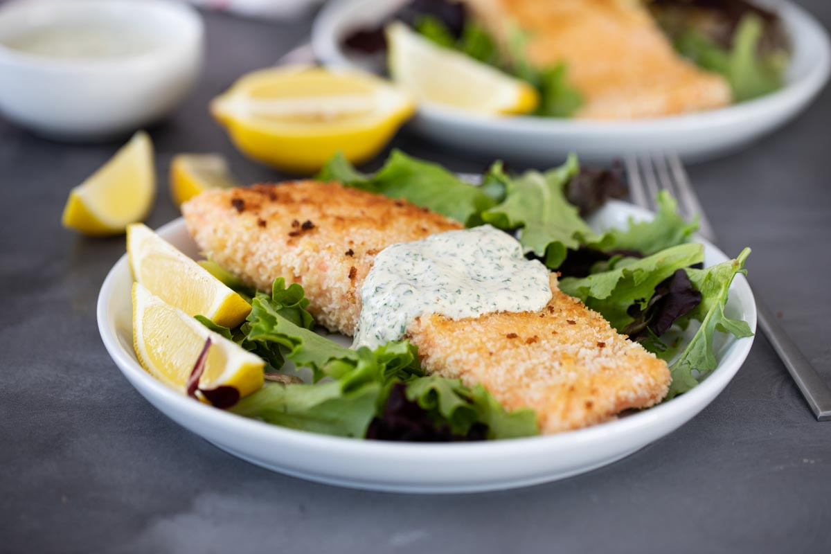 pan fried salmon on a plate with sauce
