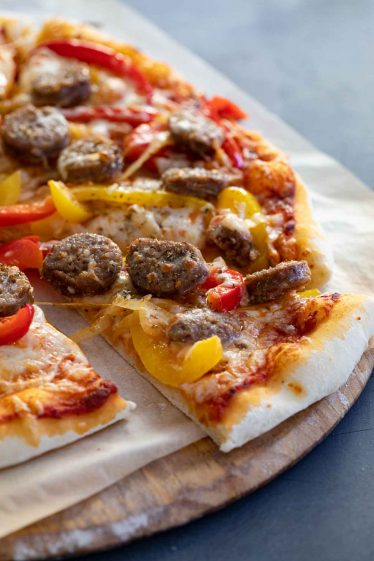 slice of pizza with sausage and peppers