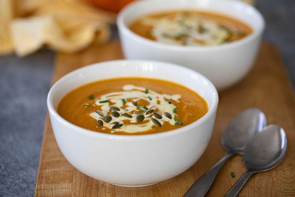 pumpkin soup with sour cream and pepitas