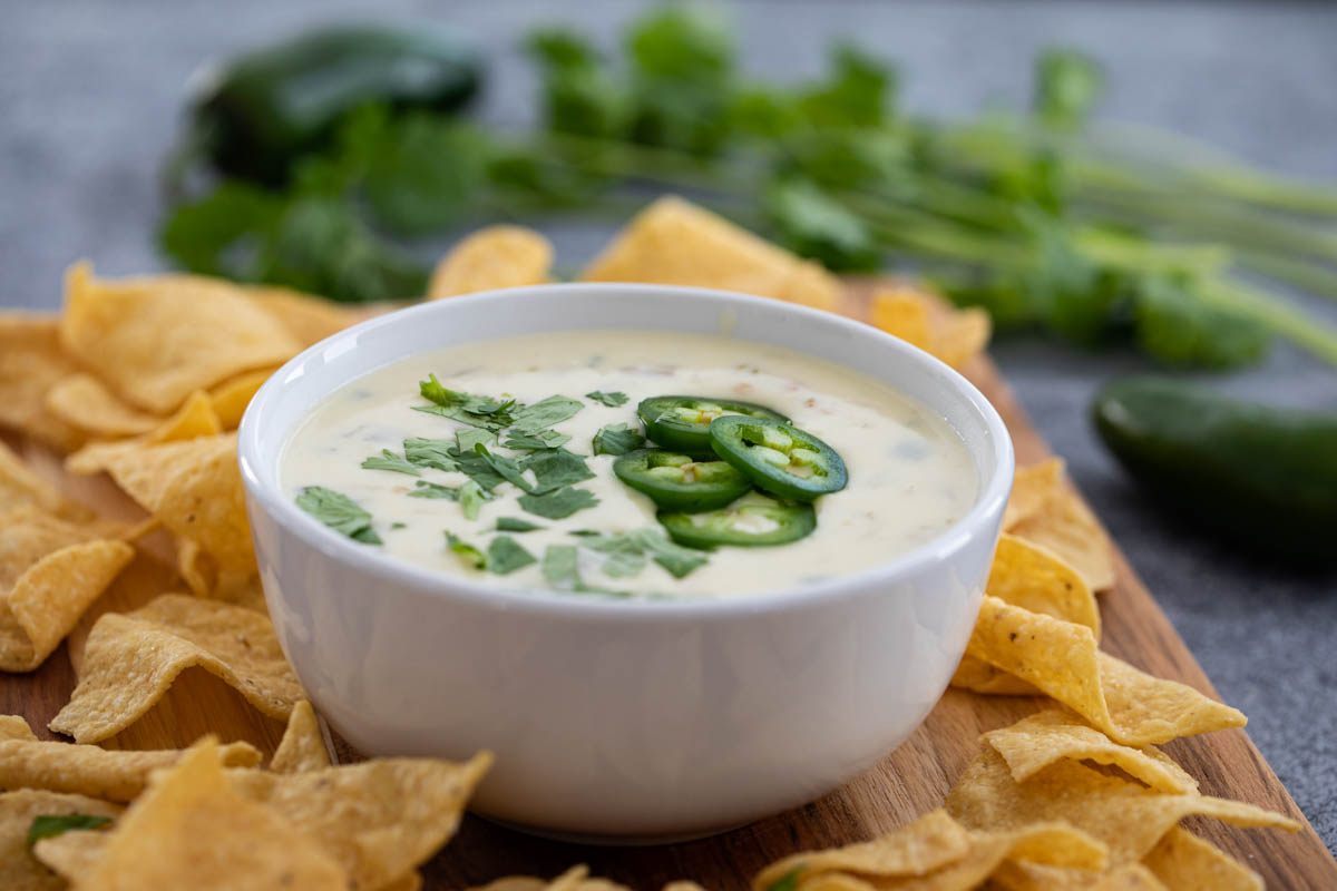 bowl of white queso blanco surrounded by tortilla chips