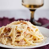 plate of bacon and brie fettuccine