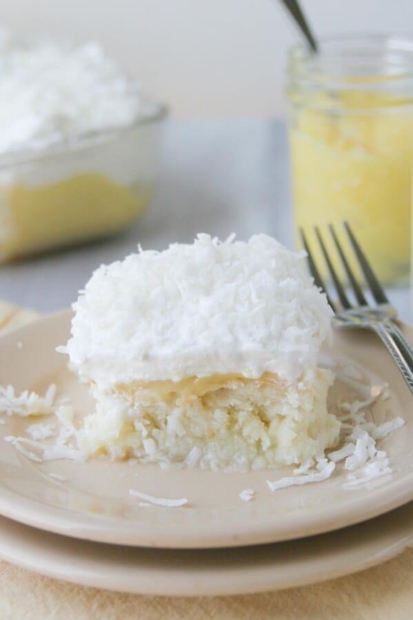 slice of lemon and coconut poke cake