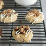 Toffee cookies topped with caramel icing and toffee