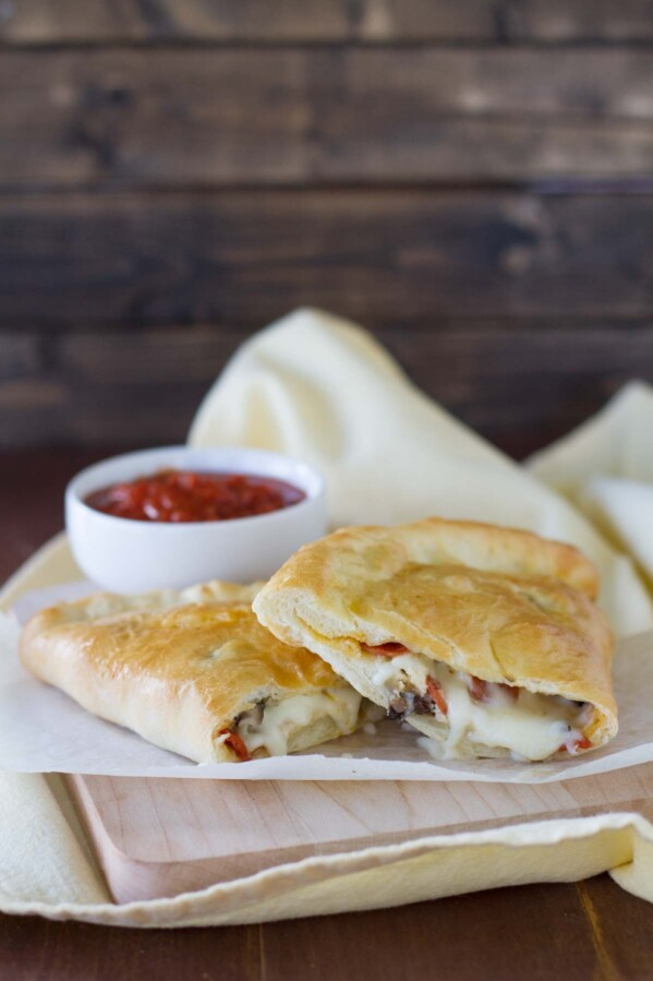 Italian Calzones Recipe filled with ricotta, cheese, pepperoni and sausage