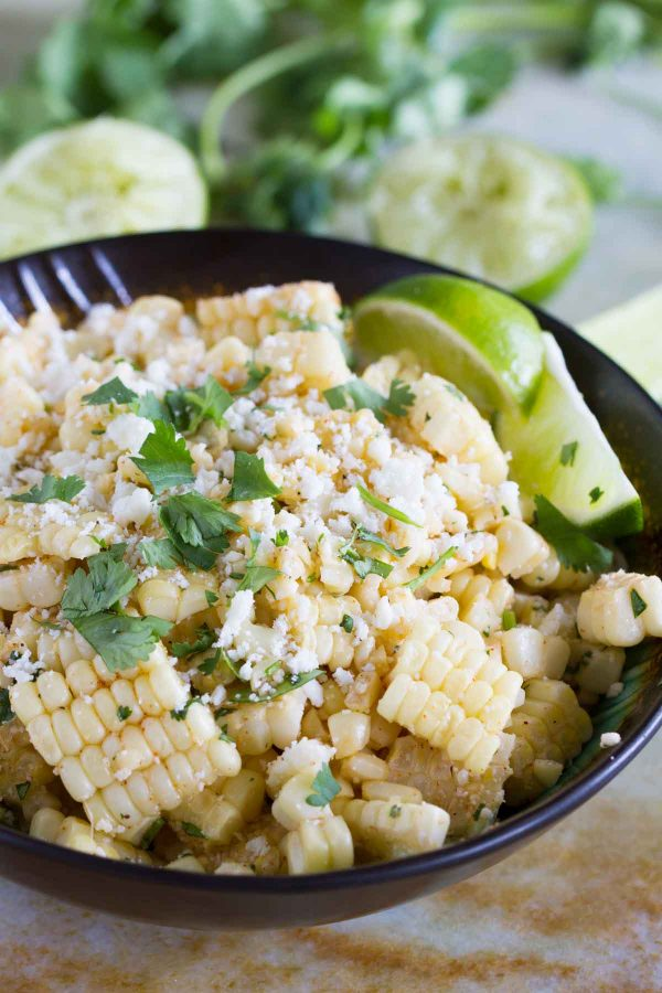 bowl of Mexican Corn Salad with lime and cilantro