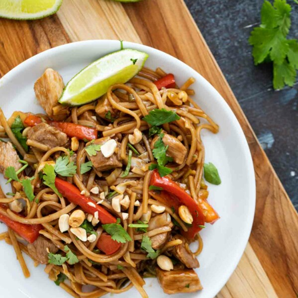 serving of pork stir fry and noodles