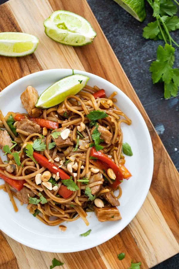 serving of pork stir fry and noodles