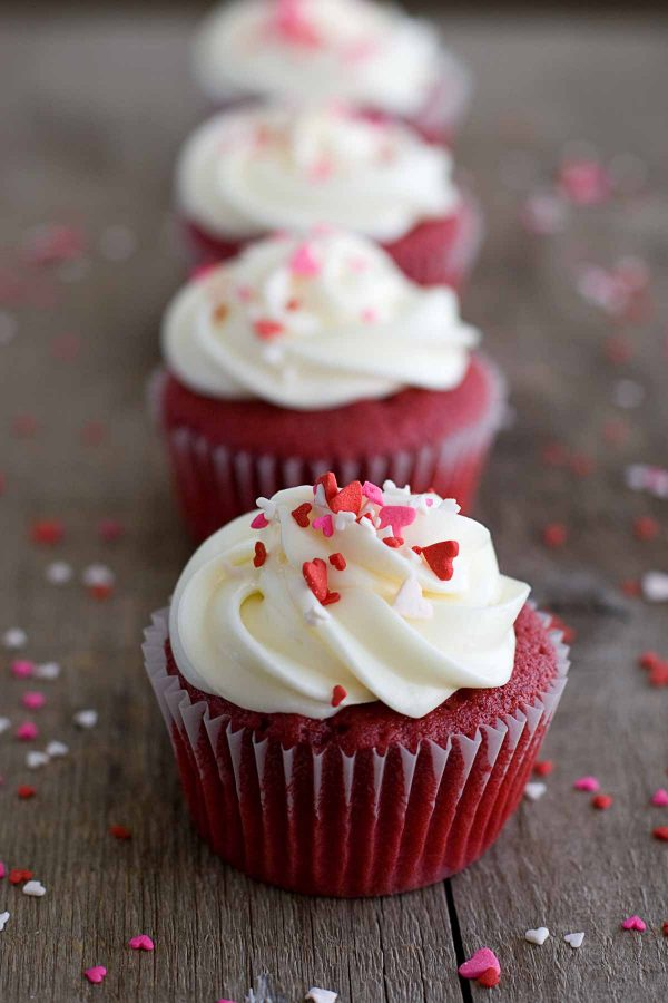 Red Velvet Cupcakes topped with frosting and sprinkles