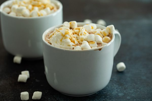 Mug of Salted Caramel Hot Chocolate Topped with Whipped Cream and Marshmallows