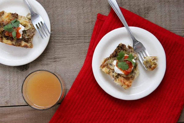 Sausage Breakfast Casserole topped with sour cream and salsa