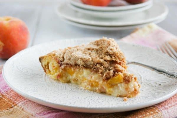 Slice of Sour Cream Peach Pie on a Plate