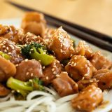Stir Fry Sesame Chicken with Broccoli over Rice Noodles
