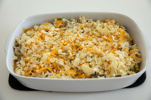 Topping a Tuna Casserole with Cheese and Potato Chips
