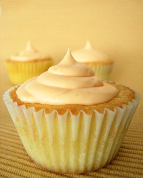 Vanilla Cupcake Topped with Orange Cream Cheese Frosting