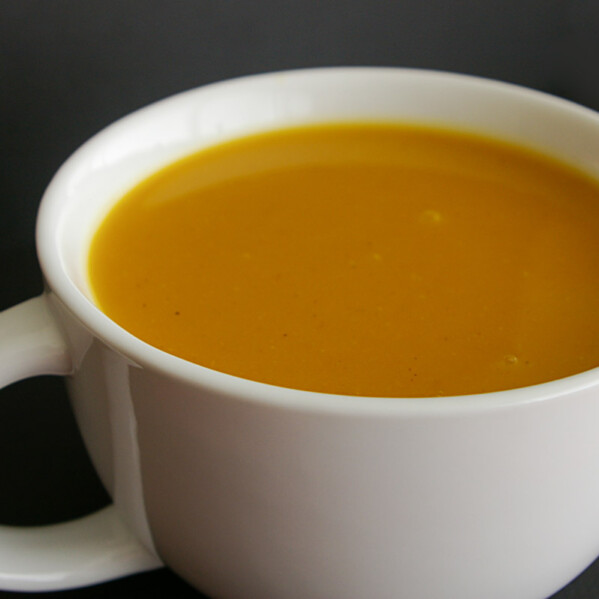 mug full of curried butternut squash soup