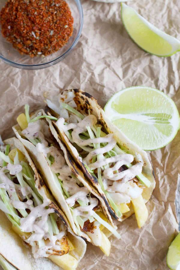 tacos with fish and fries and chipotle-lime dressing