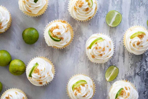 key lime cupcakes topped with graham cracker crumble