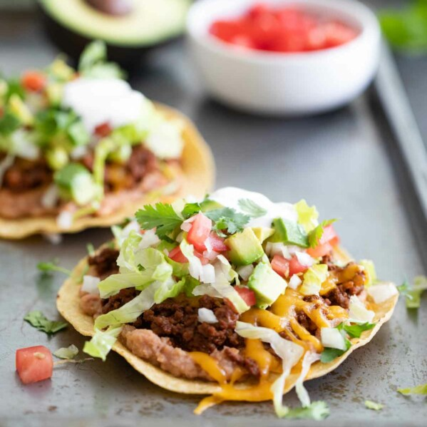 ground beef tostada with toppings
