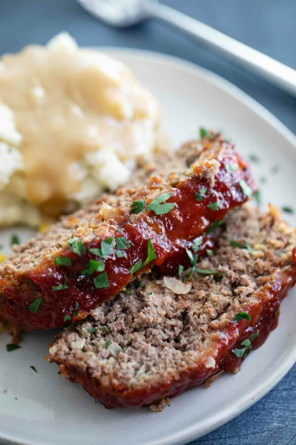 sliced meatloaf with mashed potatoes