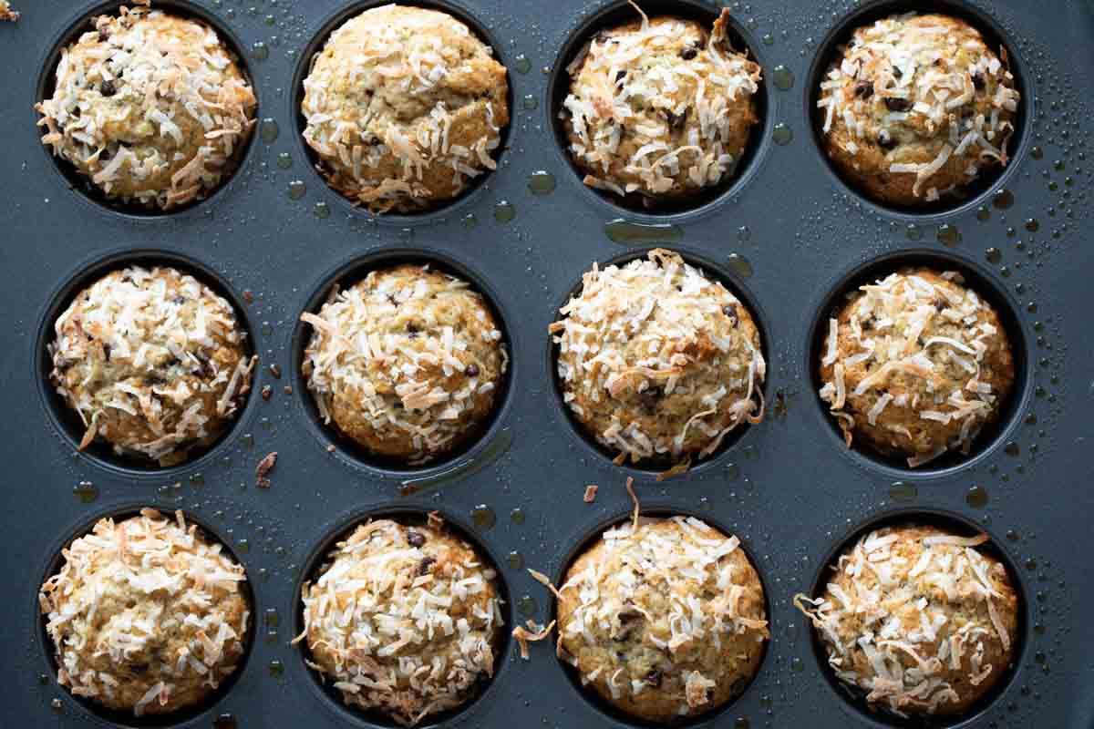 banana chocolate chip muffins in a muffin tin