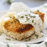 breaded pork chop with cream gravy on a plate