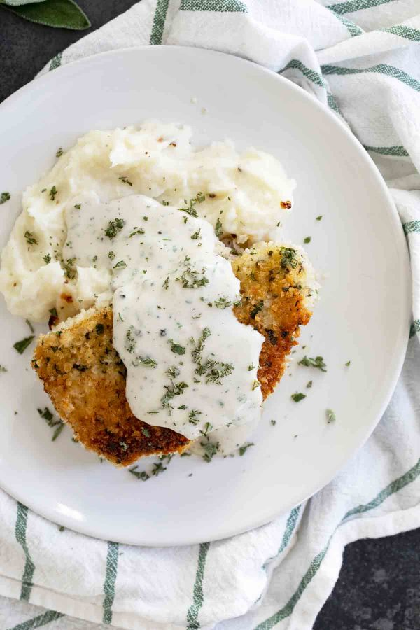 pork chops with gravy over mashed potatoes