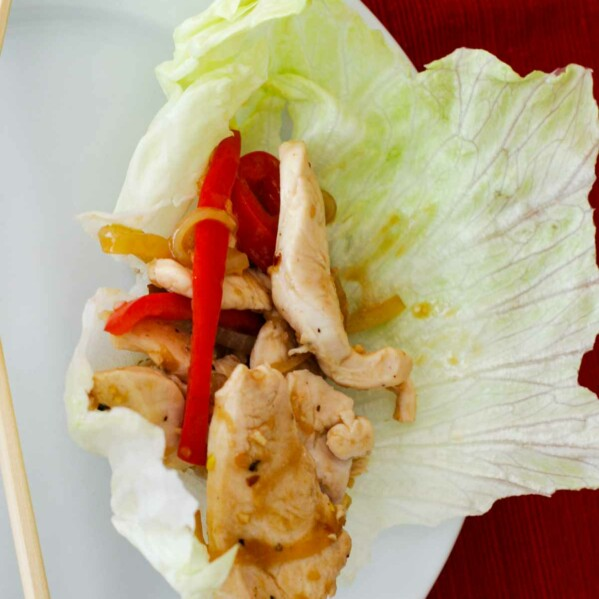Chicken Stir Fry Wraps with bell peppers in lettuce