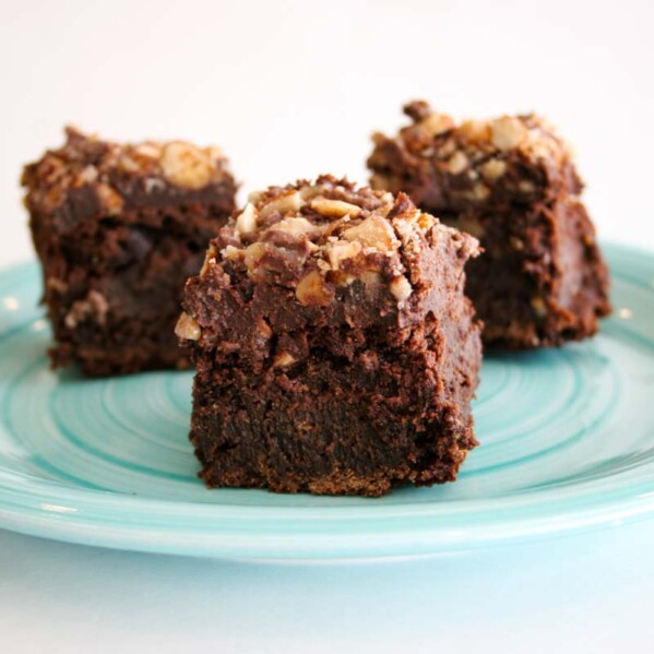 Brownies with chocolate and toffee on a plate