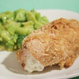 cheese stuffed chicken on a plate with broccoli