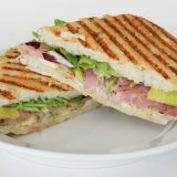 Grilled Eggplant, Prosciutto and Cheese Panini on a white plate