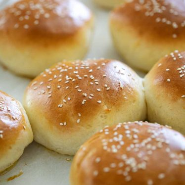 homemade hamburger buns topped with sesame seeds