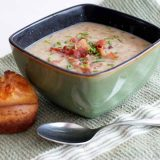 bowl of onion chowder with an onion popover on the side