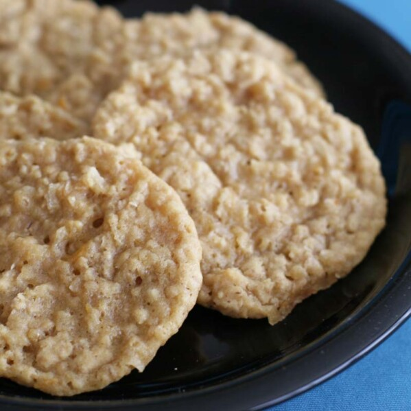 cookies with oats and orange on a black plate