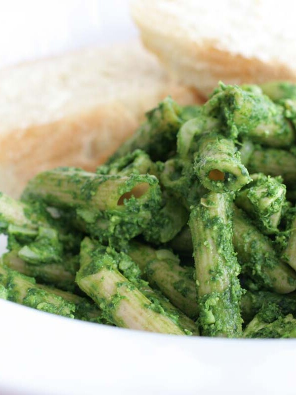 dish of pasta covered in spinach pesto