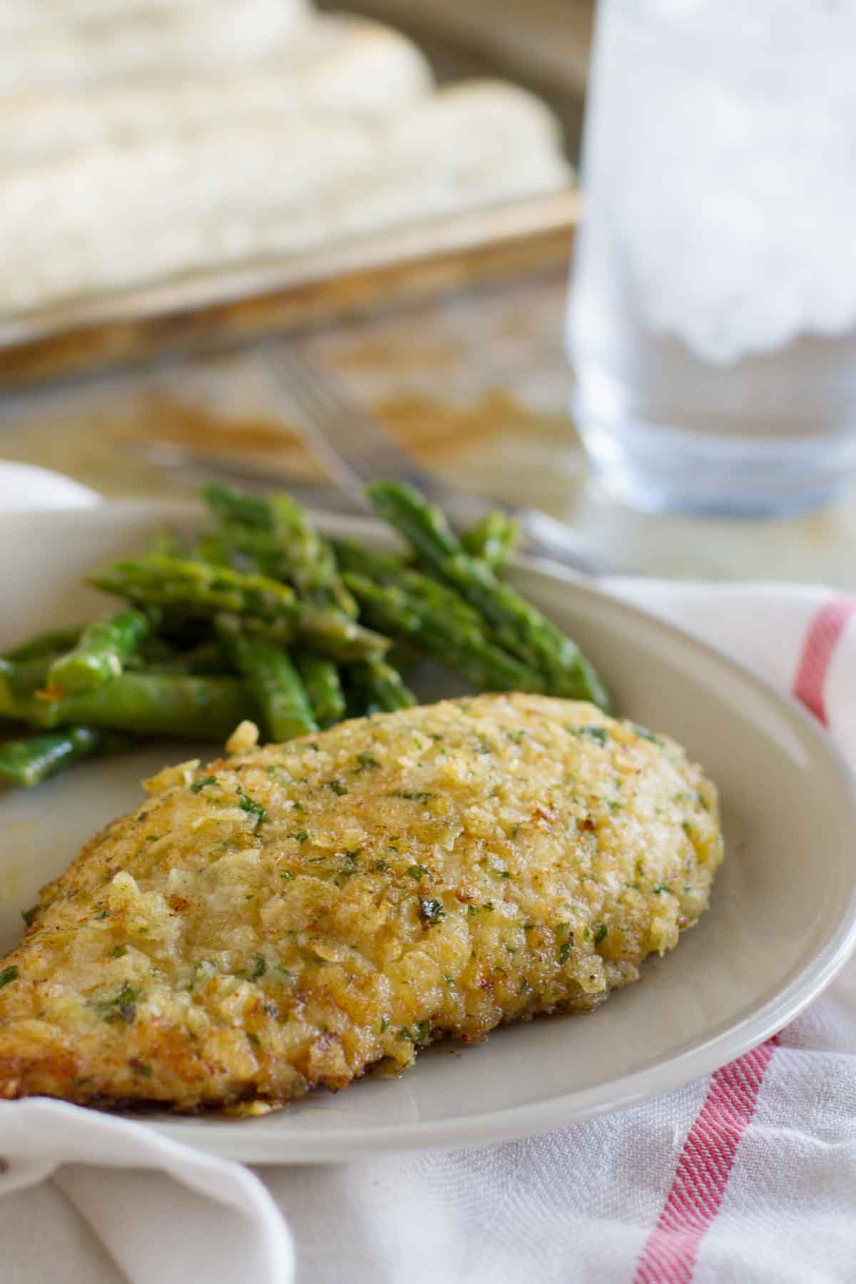 Potato Chip Chicken on a plate with asparagus