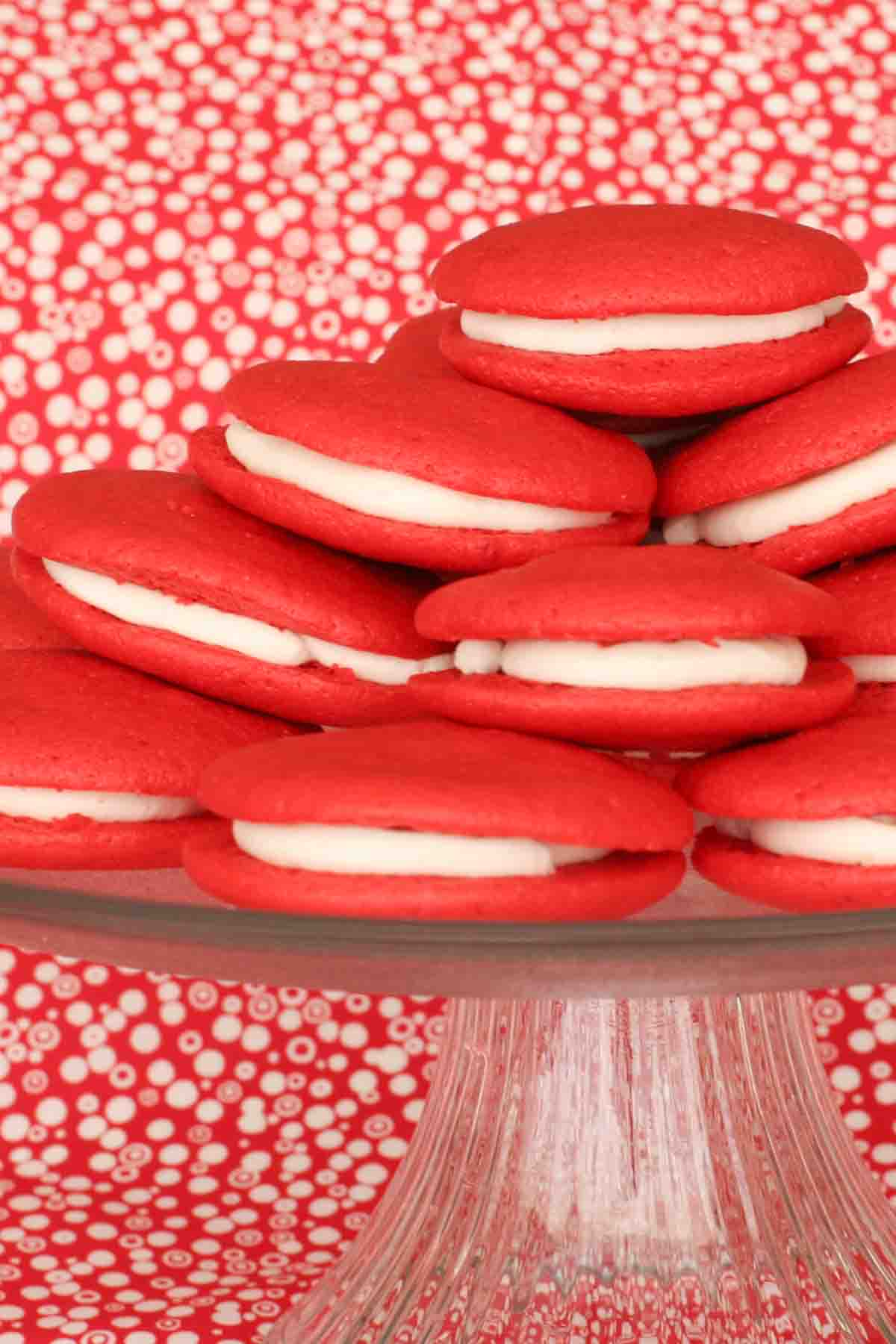 stack of red velvet whoopie pies on a cake stand