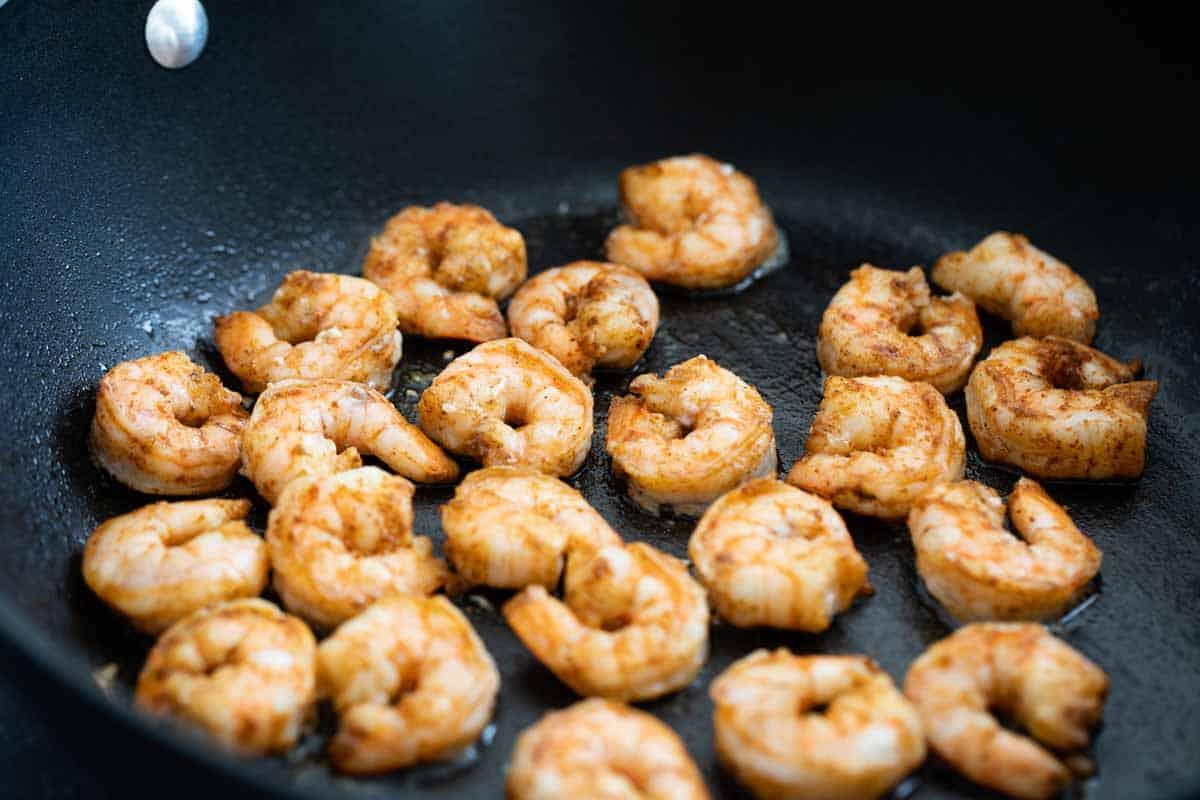 cajun spiced shrimp cooking in a skillet