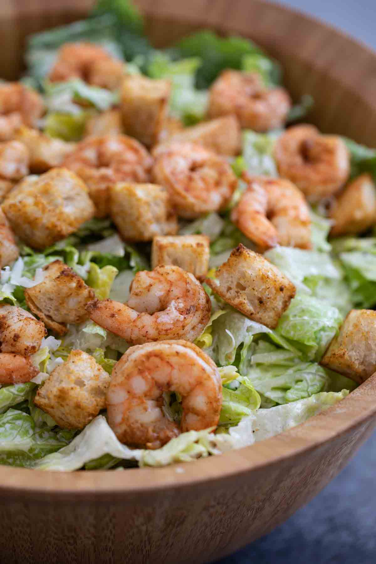 prepared Caesar salad with spicy shrimp and homemade croutons