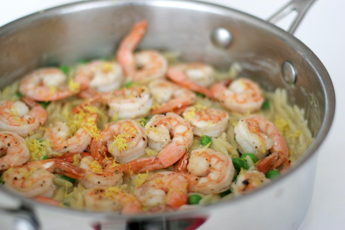 Shrimp and orzo in a skillet