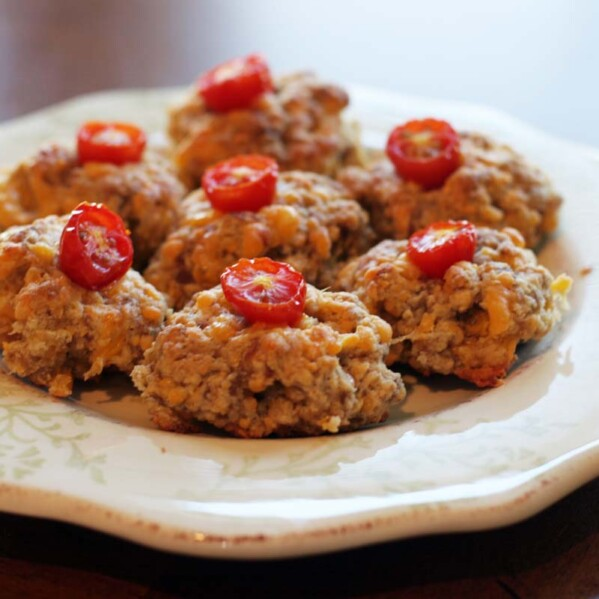 plate with sausage tomato bites
