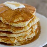stack fo corn cake pancakes with syrup