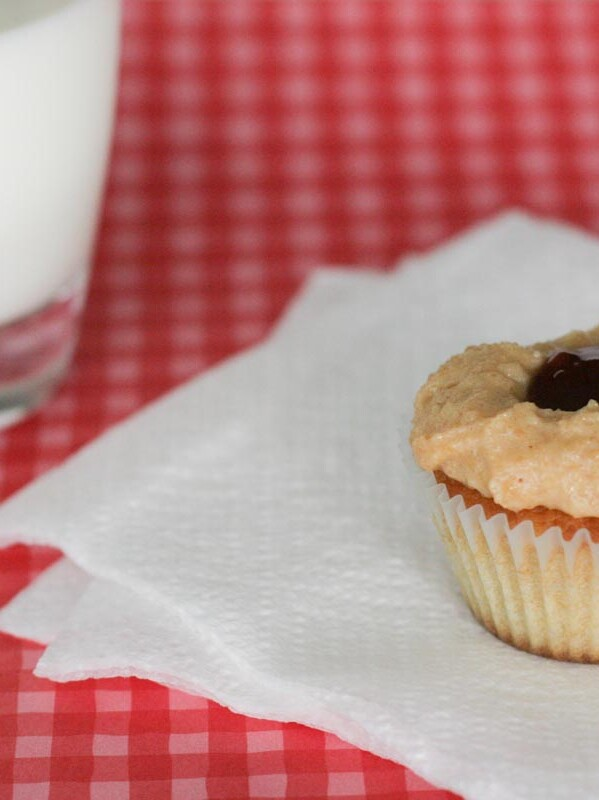 Peanut Butter Cupcake topped with peanut butter frosting and jelly in the middle