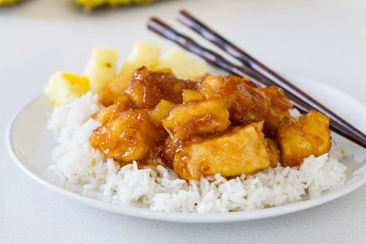 Pineapple Chicken with chopsticks and rice