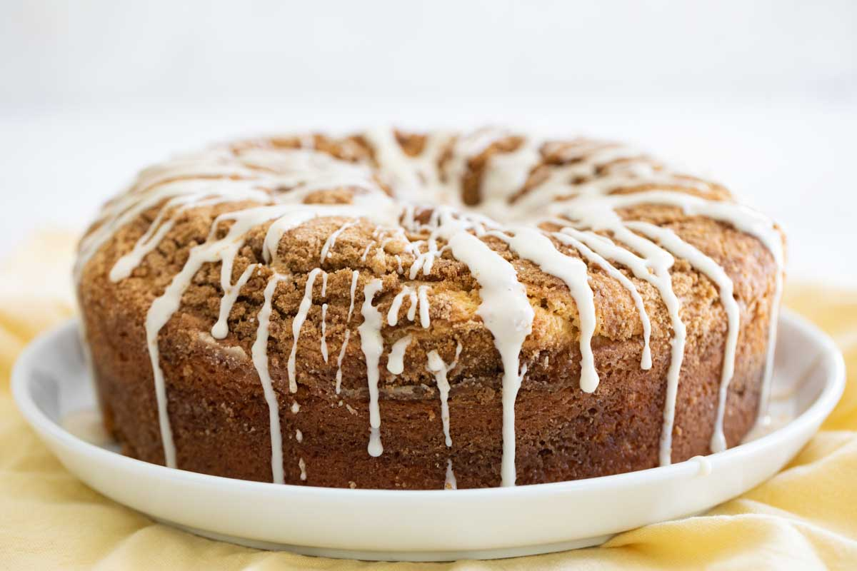 full coffee cake with glaze on a plate