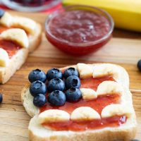 Slice of toast with toppings to look like the American flag