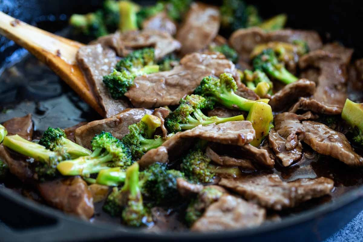 Making beef and broccoli in a cast iron pan