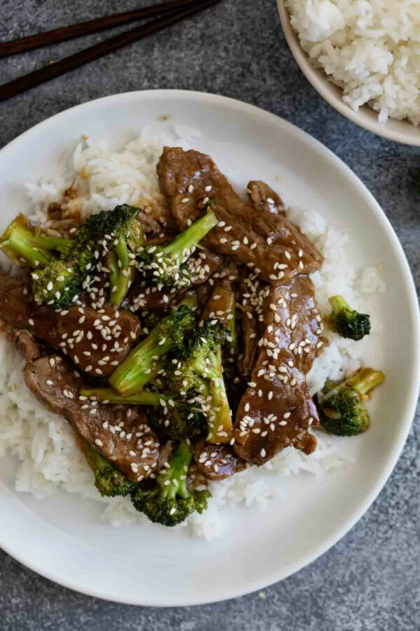 beef and broccoli sprinkled with sesame seeds over rice