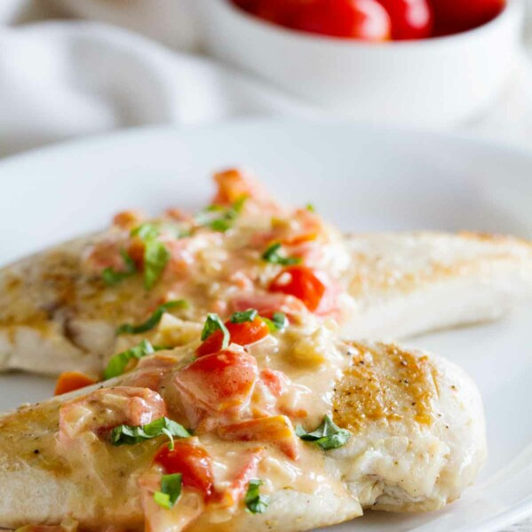 Chicken breasts topped with a cream sauce made with tomatoes, parmesan and basil