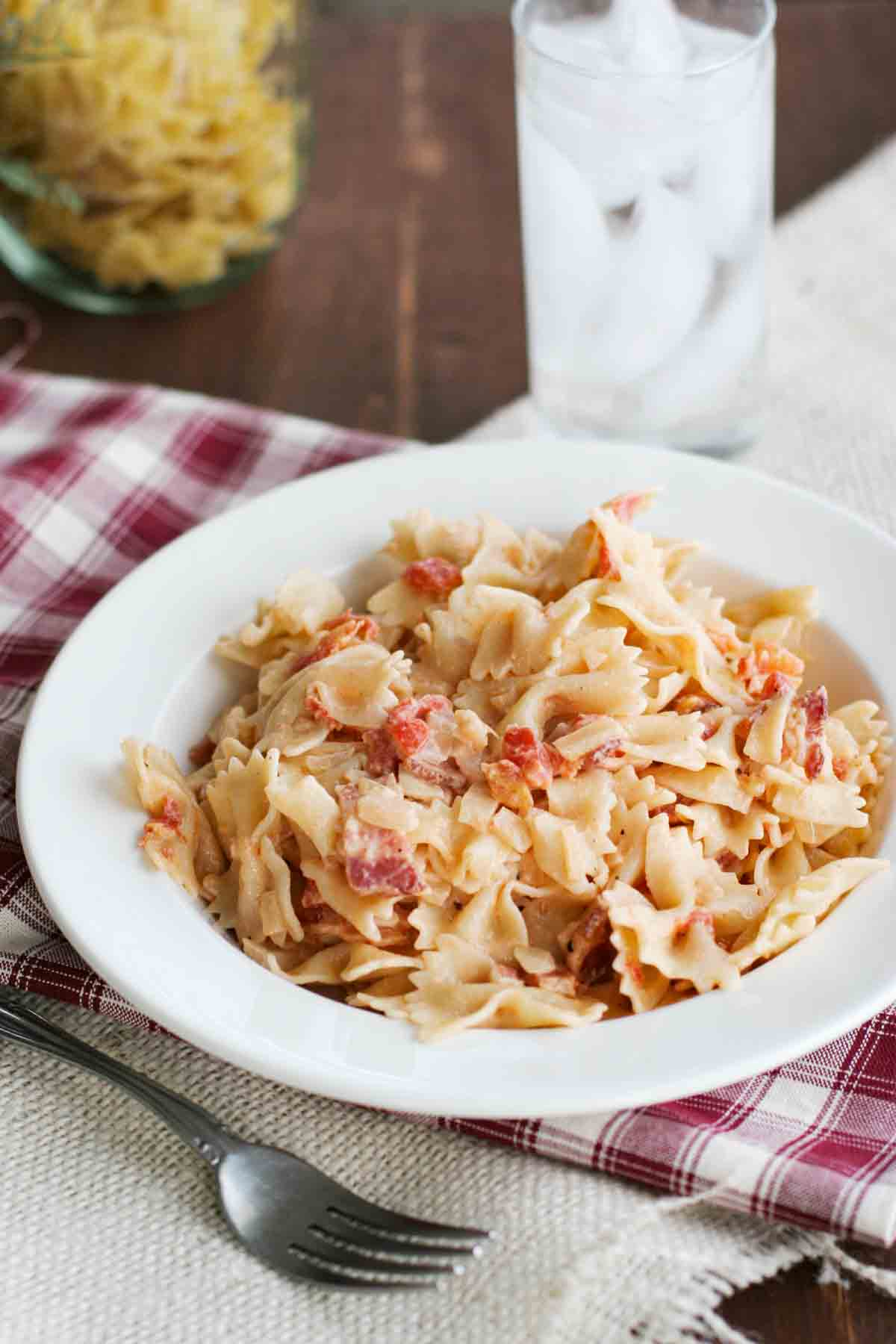 pasta with tomatoes and bacon in a bowl